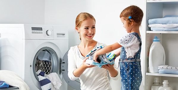 Woman and Child unloading dryer